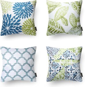set of 4 throw pillows with various leaf and patterned designs