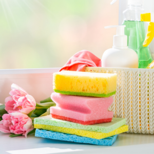 sponges stacked in front of cleaning supplies
